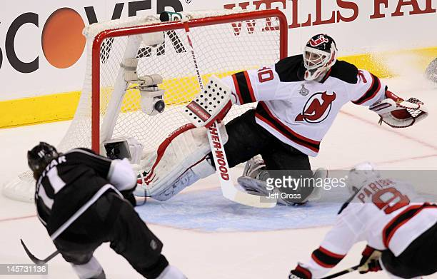 Anze Kopitar of the Los Angeles Kings scores against goaltender Martin Brodeur of the New Jersey Devils in Game Three of the 2012 Stanley Cup Final...