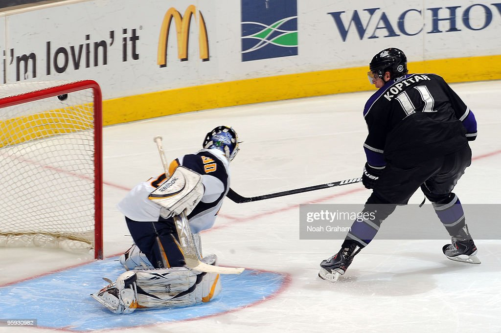 Anze Kopitar #11 of the Los Angeles Kings scores during the shootout past Ryan Miller #30 of the Buffalo Sabres on January 21, 2010 at Staples Center in Los Angeles, California.