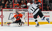 Anze Kopitar of the Los Angeles Kings scores the gamewinning goal in the shootout against Steve Mason of the Philadelphia Flyers on November 17 2015...