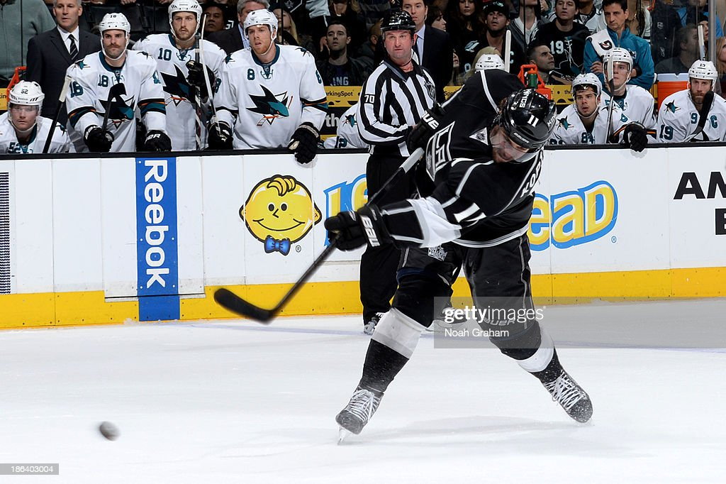 Anze Kopitar of the Los Angeles Kings shoots and scores the gamewinning goal in overtime against the San Jose Sharks at Staples Center on October 30...