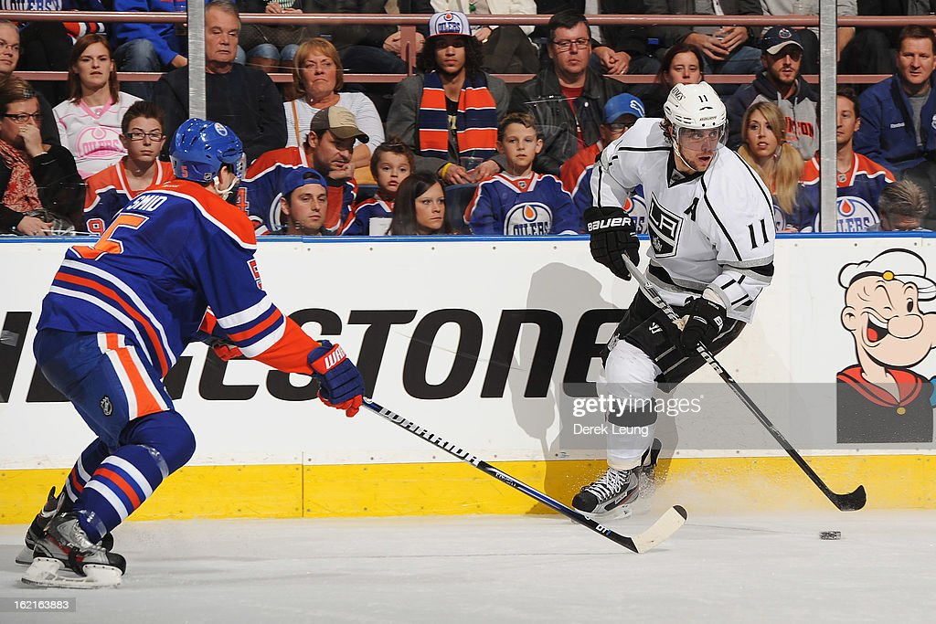 <a gi-track='captionPersonalityLinkClicked' href=/galleries/search?phrase=Anze+Kopitar&family=editorial&specificpeople=634911 ng-click='$event.stopPropagation()'>Anze Kopitar</a> #11 of the Los Angeles Kings skates against Ladislav Smid #5 of the Edmonton Oilers during an NHL game at Rexall Place on February 19, 2013 in Edmonton, Alberta, Canada. The Los Angeles Kings won 3-1.