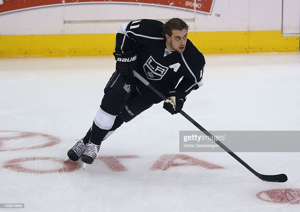 <a gi-track='captionPersonalityLinkClicked' href=/galleries/search?phrase=Anze+Kopitar&family=editorial&specificpeople=634911 ng-click='$event.stopPropagation()'>Anze Kopitar</a> #11 of the Los Angeles Kings skates during warm-up prior to the NHL game against the Tampa Bay Lightning at Staples Center on November 19, 2013 in Los Angeles, California. The Kings defeated the Lightning 5-2.
