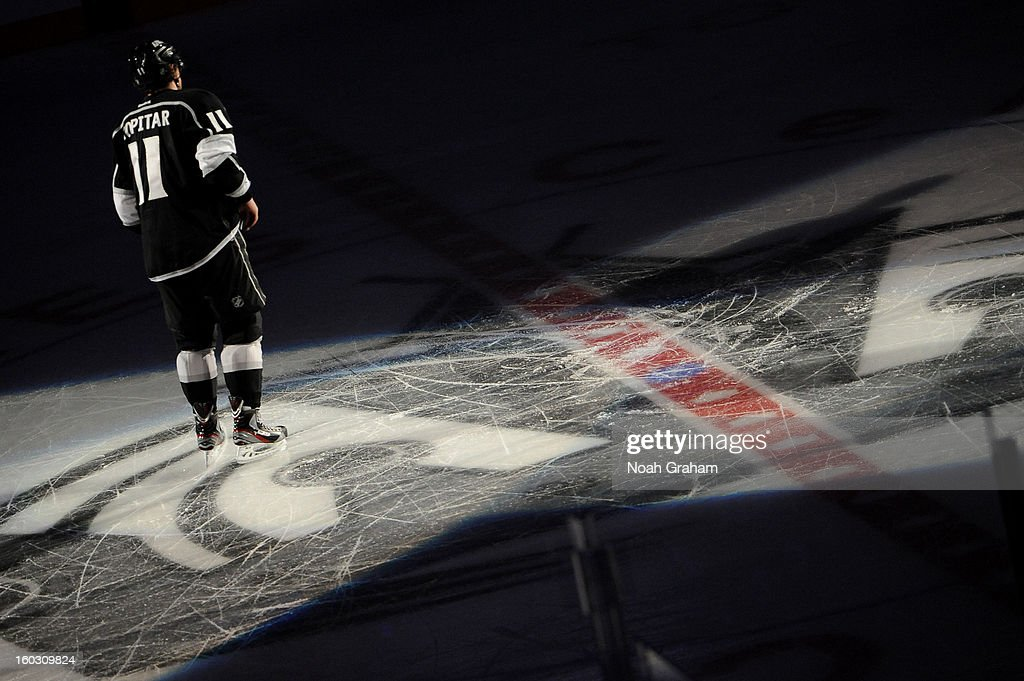 Anze Kopitar #11 of the Los Angeles Kings skates off the ice after defeating the Vancouver Canucks at Staples Center on January 28, 2013 in Los Angeles, California.