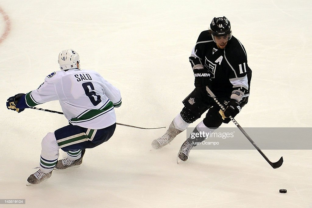 Anze Kopitar of the Los Angeles Kings skates with the puck against Sami Salo of the Vancouver Canucks in Game Four of the Western Conference...