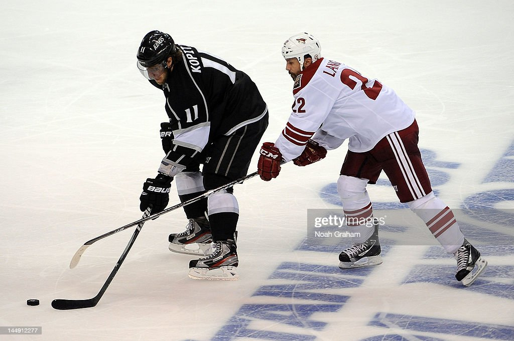 <a gi-track='captionPersonalityLinkClicked' href=/galleries/search?phrase=Anze+Kopitar&family=editorial&specificpeople=634911 ng-click='$event.stopPropagation()'>Anze Kopitar</a> #11 of the Los Angeles Kings skates with the puck against <a gi-track='captionPersonalityLinkClicked' href=/galleries/search?phrase=Daymond+Langkow&family=editorial&specificpeople=204578 ng-click='$event.stopPropagation()'>Daymond Langkow</a> #22 of the Phoenix Coyotes in Game Four of the Western Conference Finals during the 2012 NHL Stanley Cup Playoffs at Staples Center on May 20, 2012 in Los Angeles, California.