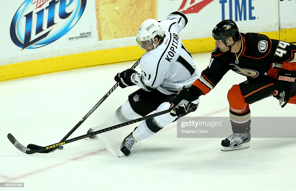 Anze Kopitar #11 of the Los Angeles Kings skates with the puck against Sheldon Souray #44 of the Anaheim Ducks at Honda Center on February 2, 2013 in Anaheim, California.