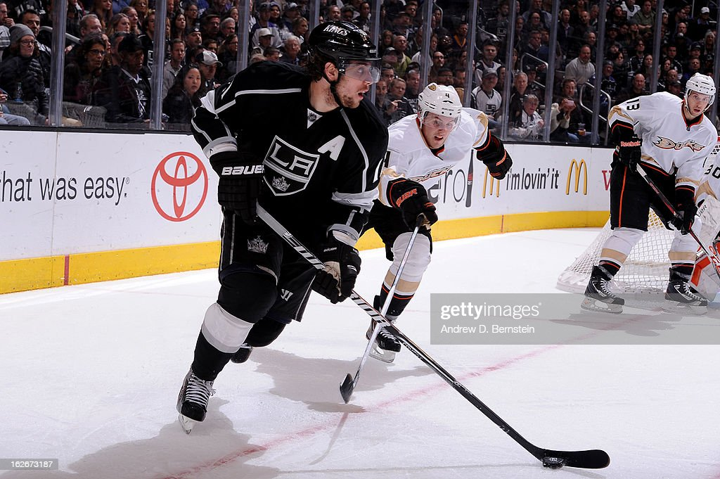 <a gi-track='captionPersonalityLinkClicked' href=/galleries/search?phrase=Anze+Kopitar&family=editorial&specificpeople=634911 ng-click='$event.stopPropagation()'>Anze Kopitar</a> #11 of the Los Angeles Kings skates with the puck against <a gi-track='captionPersonalityLinkClicked' href=/galleries/search?phrase=Cam+Fowler&family=editorial&specificpeople=5484080 ng-click='$event.stopPropagation()'>Cam Fowler</a> #4 of the Anaheim Ducks at Staples Center on February 25, 2013 in Los Angeles, California.