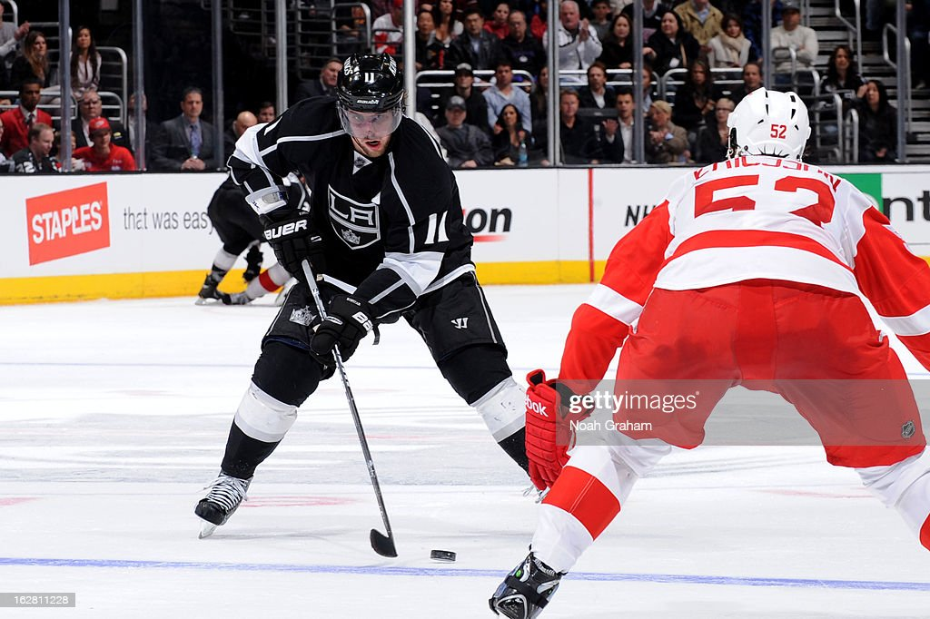 <a gi-track='captionPersonalityLinkClicked' href=/galleries/search?phrase=Anze+Kopitar&family=editorial&specificpeople=634911 ng-click='$event.stopPropagation()'>Anze Kopitar</a> #11 of the Los Angeles Kings skates with the puck against <a gi-track='captionPersonalityLinkClicked' href=/galleries/search?phrase=Jonathan+Ericsson&family=editorial&specificpeople=2538498 ng-click='$event.stopPropagation()'>Jonathan Ericsson</a> #52 of the Detroit Red Wings at Staples Center on February 27, 2013 in Los Angeles, California.