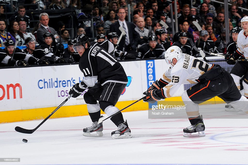 <a gi-track='captionPersonalityLinkClicked' href=/galleries/search?phrase=Anze+Kopitar&family=editorial&specificpeople=634911 ng-click='$event.stopPropagation()'>Anze Kopitar</a> #11 of the Los Angeles Kings skates with the puck against <a gi-track='captionPersonalityLinkClicked' href=/galleries/search?phrase=Francois+Beauchemin&family=editorial&specificpeople=604125 ng-click='$event.stopPropagation()'>Francois Beauchemin</a> #23 of the Anaheim Ducks at Staples Center on April 13, 2013 in Los Angeles, California.