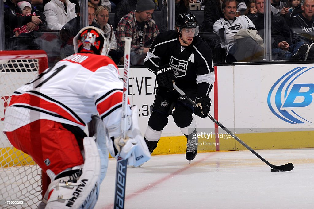 <a gi-track='captionPersonalityLinkClicked' href=/galleries/search?phrase=Anze+Kopitar&family=editorial&specificpeople=634911 ng-click='$event.stopPropagation()'>Anze Kopitar</a> #11 of the Los Angeles Kings skates with the puck against the Carolina Hurricanes at Staples Center on March 1, 2014 in Los Angeles, California.