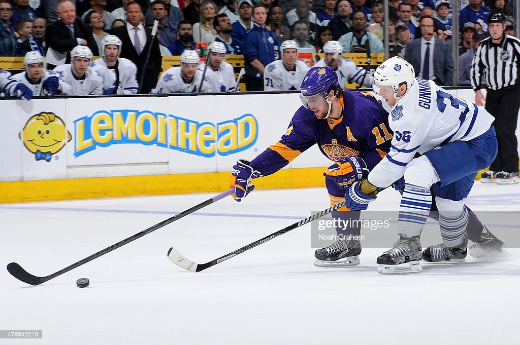 <a gi-track='captionPersonalityLinkClicked' href=/galleries/search?phrase=Anze+Kopitar&family=editorial&specificpeople=634911 ng-click='$event.stopPropagation()'>Anze Kopitar</a> #11 of the Los Angeles Kings skates with the puck against <a gi-track='captionPersonalityLinkClicked' href=/galleries/search?phrase=Carl+Gunnarsson&family=editorial&specificpeople=5557315 ng-click='$event.stopPropagation()'>Carl Gunnarsson</a> #36 of the Toronto Maple Leafs at Staples Center on March 13, 2014 in Los Angeles, California.