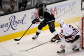 Anze Kopitar of the Los Angeles Kings skates with the puck against Michal Rozsival of the Chicago Blackhawks in Game Six of the Western Conference...