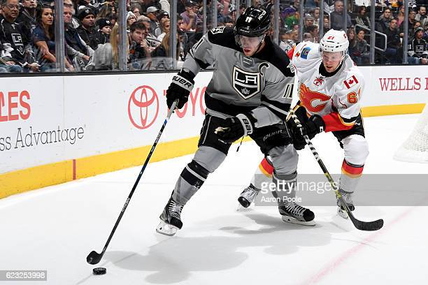 Anze Kopitar of the Los Angeles Kings skates with the puck against Brett Kulak of the Calgary Flames on November 5 2016 at Staples Center in Los...