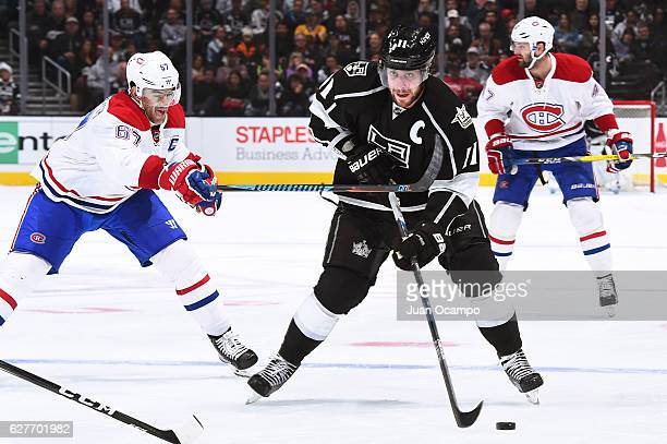 Anze Kopitar of the Los Angeles Kings skates with the puck against Max Pacioretty of the Montreal Canadiens during the game on December 4 2016 at...