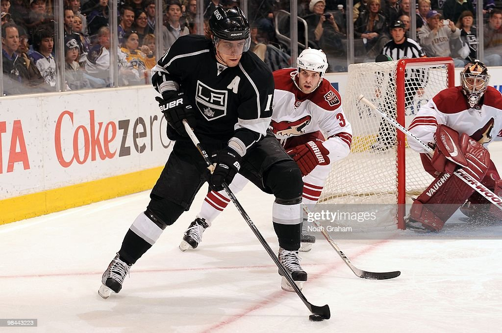 Anze Kopitar of the Los Angeles Kings skates with the puck against Keith Yandle of the Phoenix Coyotes on April 8 2010 at Staples Center in Los...