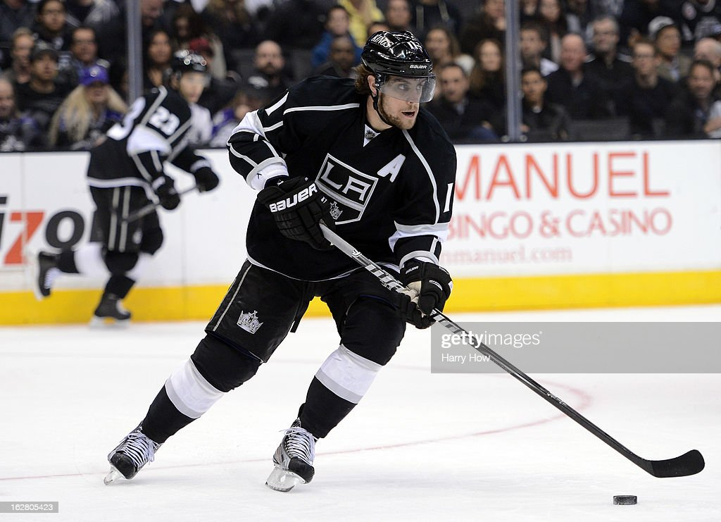 Anze Kopitar #11 of the Los Angeles Kings starts a rush with Dustin Brown #23 during the game against the Anaheim Ducks at Staples Center on February 25, 2013 in Los Angeles, California.