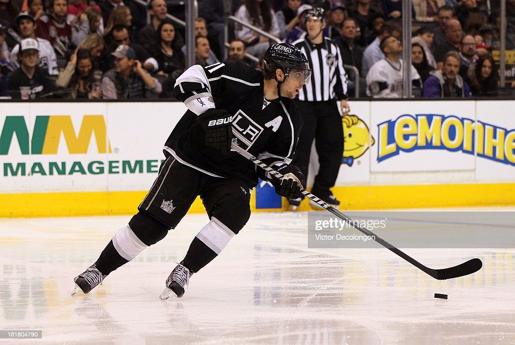 Anze Kopitar #11 of the Los Angeles Kings turns to skate the puck out of the Kings zone during the NHL game against the Columbus Blue Jackets at Staples Center on February 15, 2013 in Los Angeles, California.