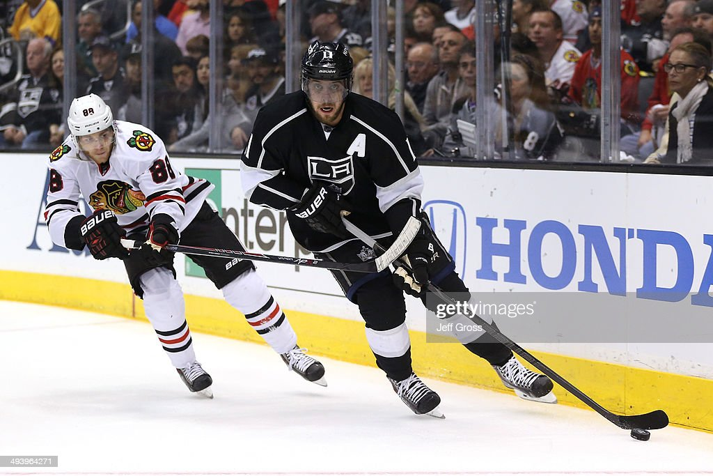 Anze Kopitar #11 of the Los Angeles Kings with the puck against Patrick Kane #88 of the Chicago Blackhawks in the first period in Game Four of the Western Conference Final during the 2014 Stanley Cup Playoffs at Staples Center on May 26, 2014 in Los Angeles, California.