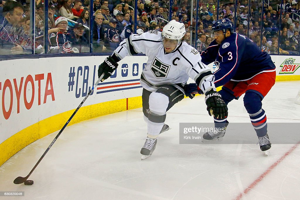 Anze Kopitar #11 of the Los Angeles Kings works to keep control of the puck away from Seth Jones #3 of the Columbus Blue Jackets during the third period on December 20, 2016 at Nationwide Arena in Columbus, Ohio. Columbus defeated Los Angeles 3-2 in a shootout.
