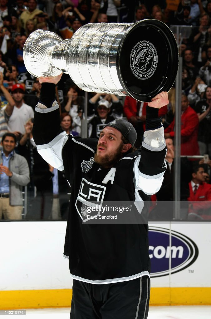 Anze Kopitar of the Los Angeles Kinng lifts the Stanley Cup after the Los Angeles Kings defeated the New Jersey Devils 61 in Game Six of the 2012...