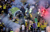 Anzhi Makhachkala fans light flares during the Russian Premier League match between FC Anzhi Makhachkala and FC Rubin Kazan at the Anzhi Arena...
