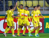 Anzhi Makhachkala players celebrate after a goal is scored for their team during the Russian Premier League match between FC Anzhi Makhachkala and FC...