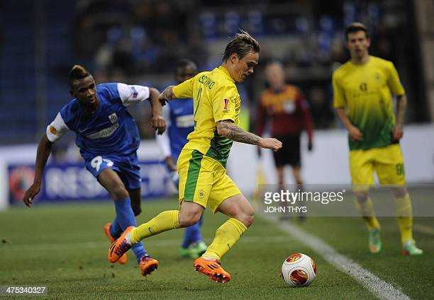 Anzhi Makhachkala's defender Andrei Eschenko vies with Genk's forward Ilombe Mboyo during the round of 32 Europa League UEFA football match between...