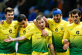Anzhi Makhachkala's forward Olexandr Aliyev celebrates with teammates after scoring during the round of 32 Europa League UEFA football match between...