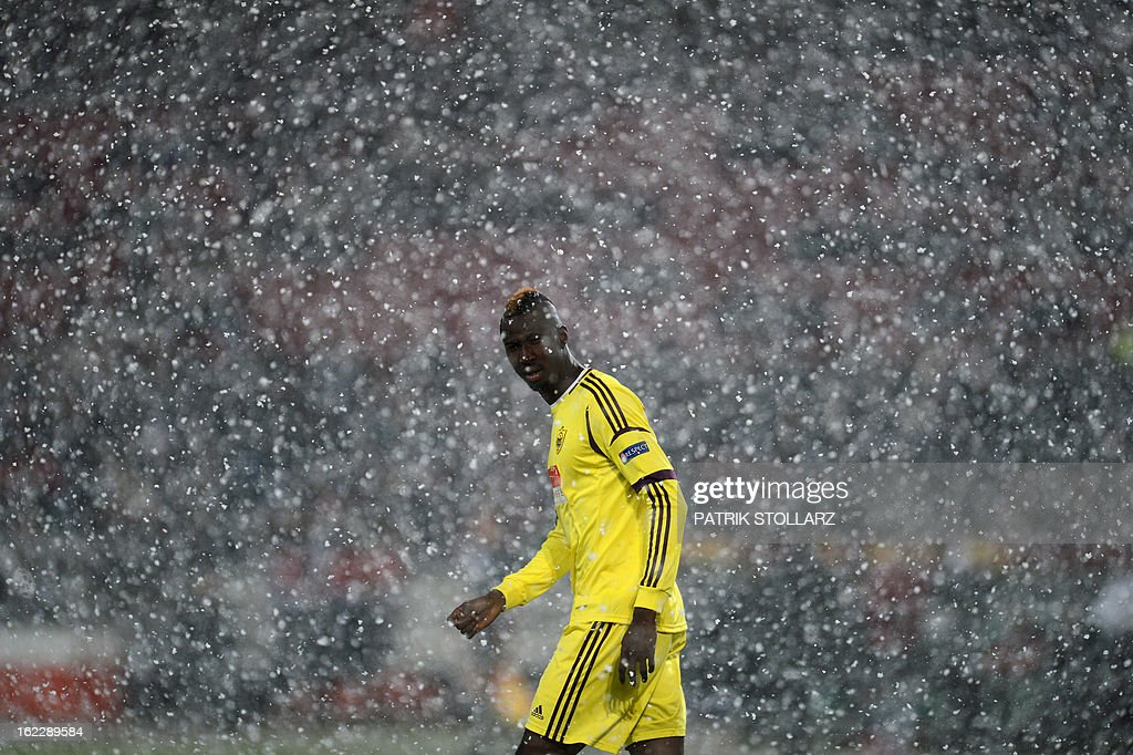 Anzhi Makhachkala's Ivorian striker Lacina Traore walks through the snow during the UEFA Europa League Round of 32 football match Hannover 96 vs FC Anzhi Makhachkala in Hanover, northern Germany on February 21, 2013.