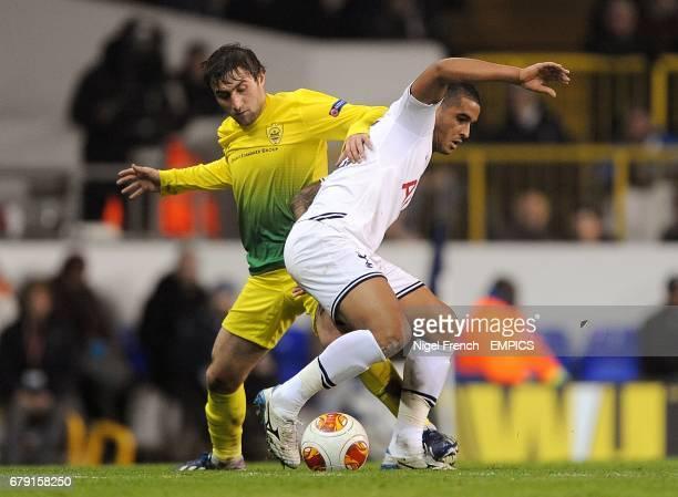 Anzhi Makhachkala's Kamil Agalarov and Tottenham Hotspur's Kyle Naughton battle for the ball