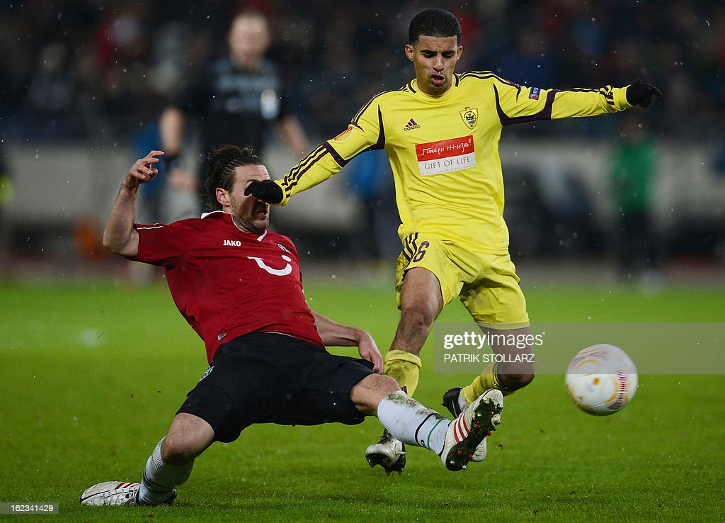 Anzhi Makhachkala's Moroccan striker Mbark Boussoufa (R) and Hanover's defender Christian Schulz vie for the ball during the UEFA Europa League Round of 32 football match Hannover 96 vs FC Anzhi Makhachkala in Hanover, northern Germany on February 21, 2013.