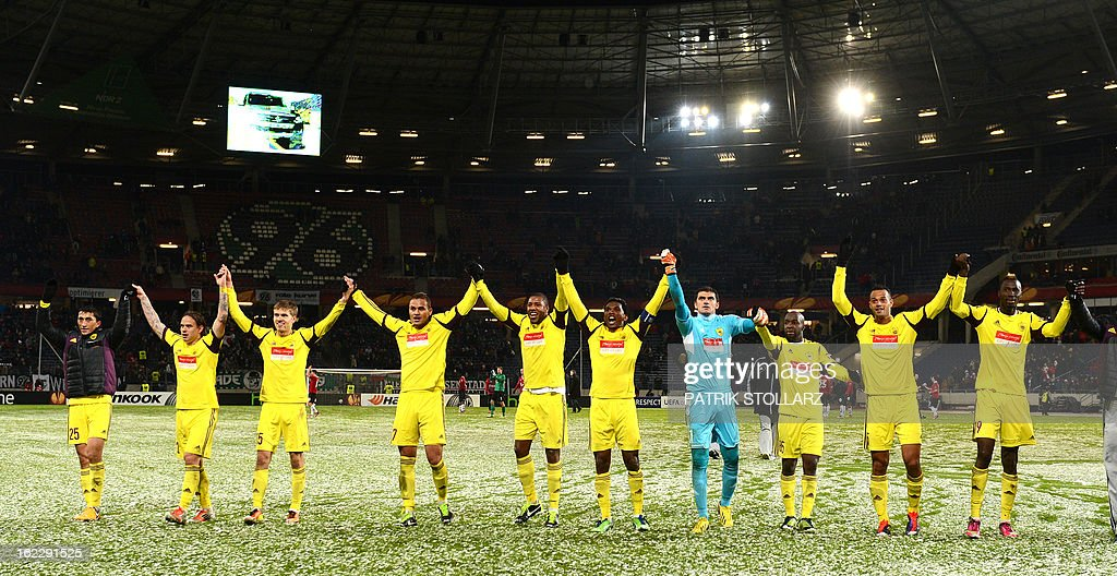 Anzhi Makhachkala's players celebrate after the UEFA Europa League Round of 32 football match Hannover 96 vs FC Anzhi Makhachkala in Hanover, northern Germany on February 21, 2013. The match ended 1-1.