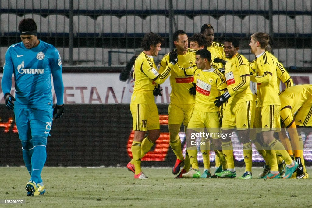 Anzhi players celebrate a goal scored by Carlos Joao of FC Anzhi Makhachkala (3rd L) during the Russian Football Premier League match between FC Zenit St. Petersburg and FC Anzhi Makhachkala at the Petrovsky Stadium on December 10, 2012 in St. Petersburg, Russia.