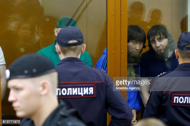 Anzor Gubashev and Zaur Dadayev who are convicted of organizing and carrying out the contract killing of opposition leader Boris Nemtsov stand inside...