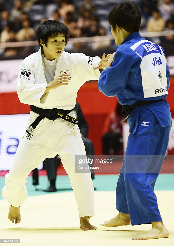 Anzu Yamamoto (L) and Nae Udaka of Japan compete in the Women's 57kg first round match during day one of the Judo Grand Slamat Yoyogi Gymnasium on November 30, 2012 in Tokyo, Japan.
