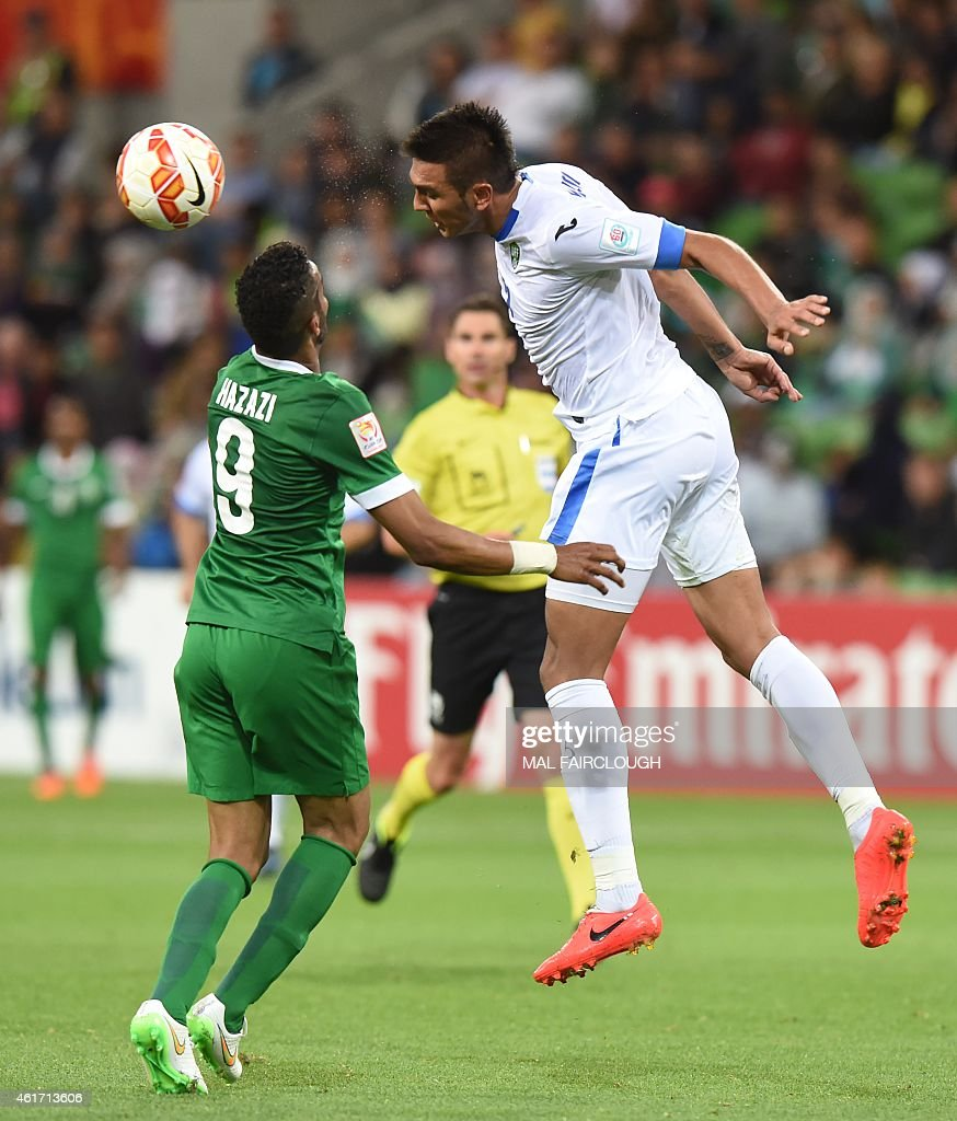 Anzur Ismailov of Uzbekistan (R) heads the ball away from <a gi-track='captionPersonalityLinkClicked' href=/galleries/search?phrase=Naif+Hazazi&family=editorial&specificpeople=5779932 ng-click='$event.stopPropagation()'>Naif Hazazi</a> of Saudi Arabia during the Group B Asian Cup football match between Uzbekistan and Saudi Arabia in Melbourne on January 18, 2015.