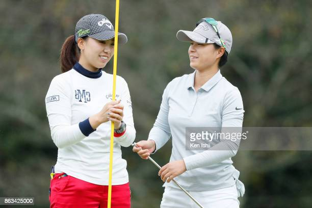 Aoi Nagata and Kana Taneda of Japan talk on the 10th hole during the final round of the Kyoto Ladies Open at the Joyo Country Club on October 20 2017...