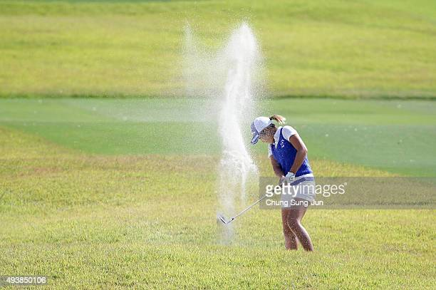 Aoi Ohnishi of Japan plays a bunker shot on the 18th hole during the second round of the Nobuta Group Masters GC Ladies at the Masters Gold Club on...
