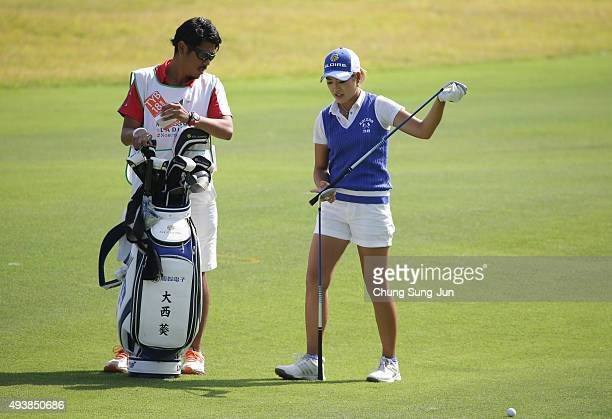 Aoi Ohnishi of Japan prepares for shot on the 18th hole during the second round of the Nobuta Group Masters GC Ladies at the Masters Gold Club on...