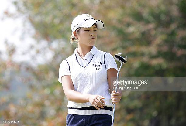 Aoi Ohnishi of Japan reacts after a putt on the 8th green during the third round of the Nobuta Group Masters GC Ladies at the Masters Gold Club on...