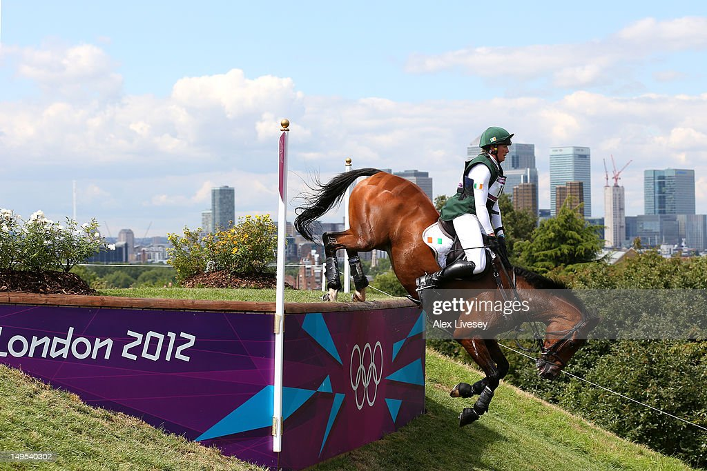 Aoife Clark of Ireland riding Master Crusoe negotiates an obstacle in the Eventing Cross Country Equestrian event on Day 3 of the London 2012 Olympic...