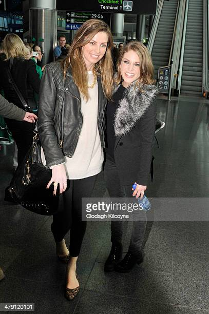 Aoife Cogan wife of Gordon D'Arcy and Amy Huberman wife of Brian O'Driscoll smile as they join the Ireland RBS Six Nations Rugby Championship winners...