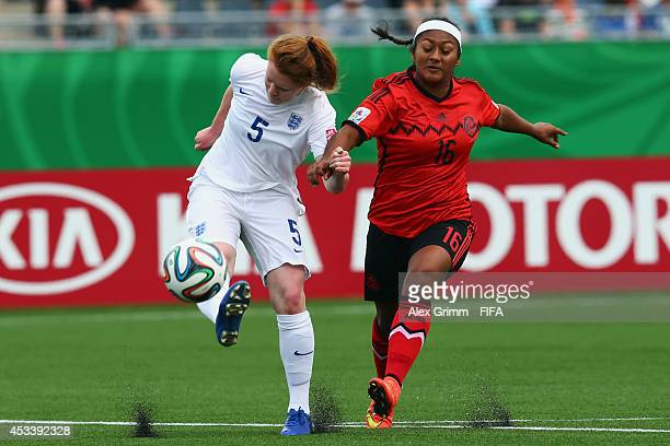 Aoife Mannion of England is challenged by Claudia Lopez of Mexico during the FIFA U20 Women's World Cup Canada 2014 group C match between England and...