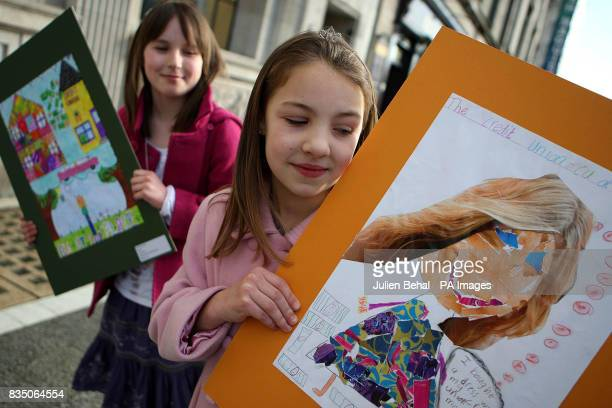 Aoife McGee left from Letterkenny CoDonegal and Kate Nelson from Dublin with their winning designs for the Credit Union AllIreland Poster Competition...
