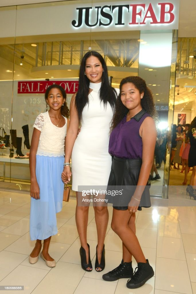 Aoki Lee Simmons, Kimora Lee Simmons and Ming Lee Simmons attend the JustFab Boutique grand opening with Kimora Lee Simmons at JustFab Flagship Store on September 14, 2013 in Glendale, California.