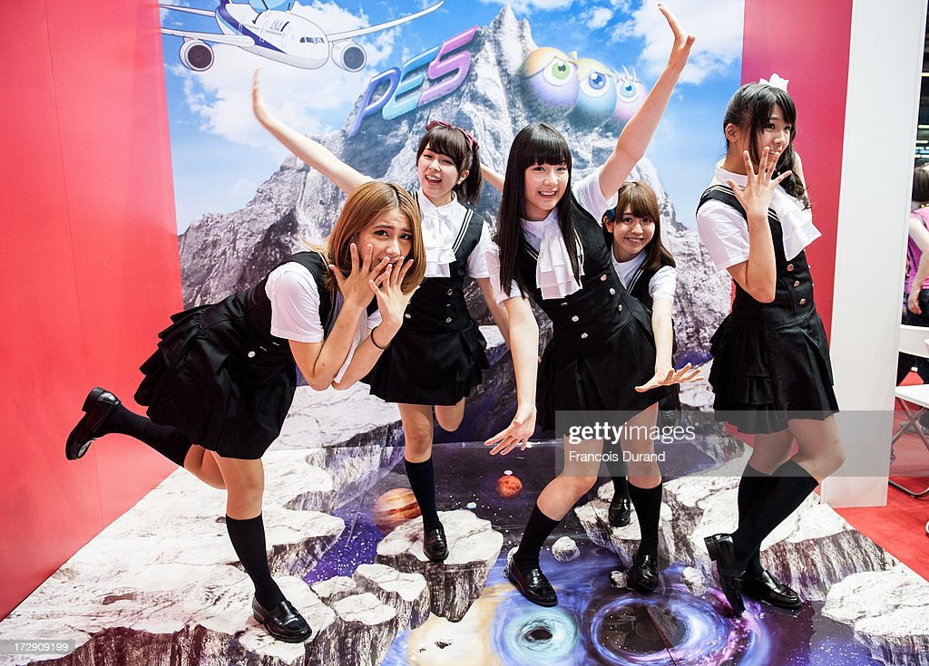 AoP singers poses at 'TOYOTA x STUDIO4AC meets ANA PES' booth during the Japan Expo at Paris-nord Villepinte Exhibition Center on July 5, 2013 in Paris, France.