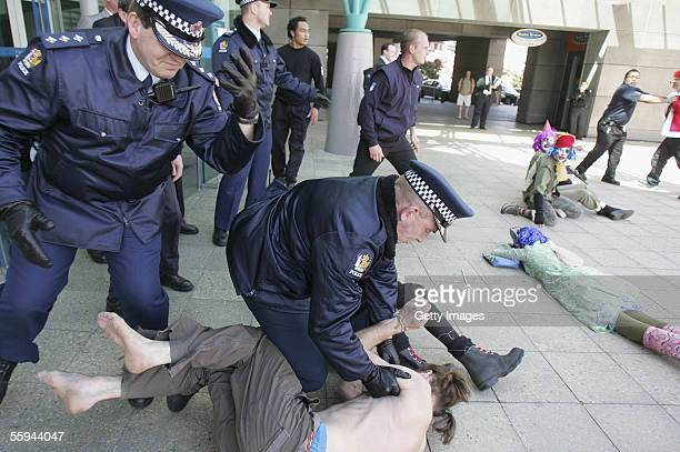 Aotearoa Anti War Clown League members burst through police lines knocking them to the ground as they try to storm into the Museum of New Zealand 'Te...