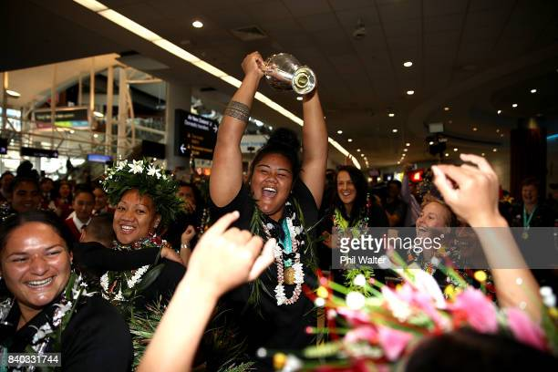 Aotearoa Mata'u of the Black Ferns dances with the trophy as the New Zealand Black Ferns arrive at Auckland International Airport on August 29 2017...