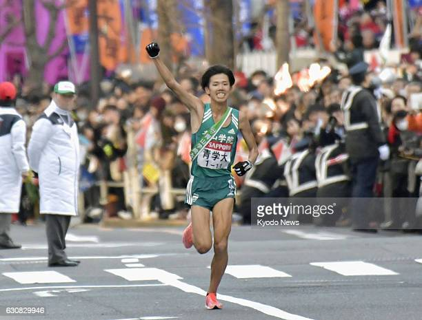 Aoyama Gakuin University anchor Yuya Ando runs to the finish line of the TokyoHakone collegiate ekiden road relay on Jan 3 in Tokyo Aoyama Gakuin won...