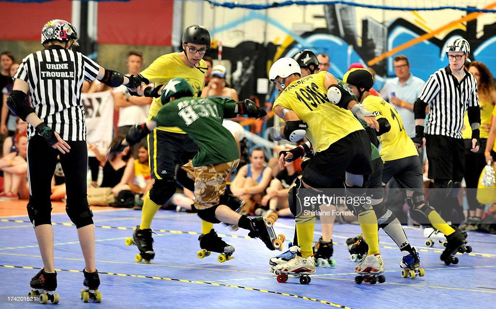 Apa Chi of Chaos Engine performs an apex jump while competing against Capt'n Wynne and Passpa'ss of Panam Squad in the Mens European Roller Derby Championships at Futsal on July 21, 2013 in Birmingham, England.